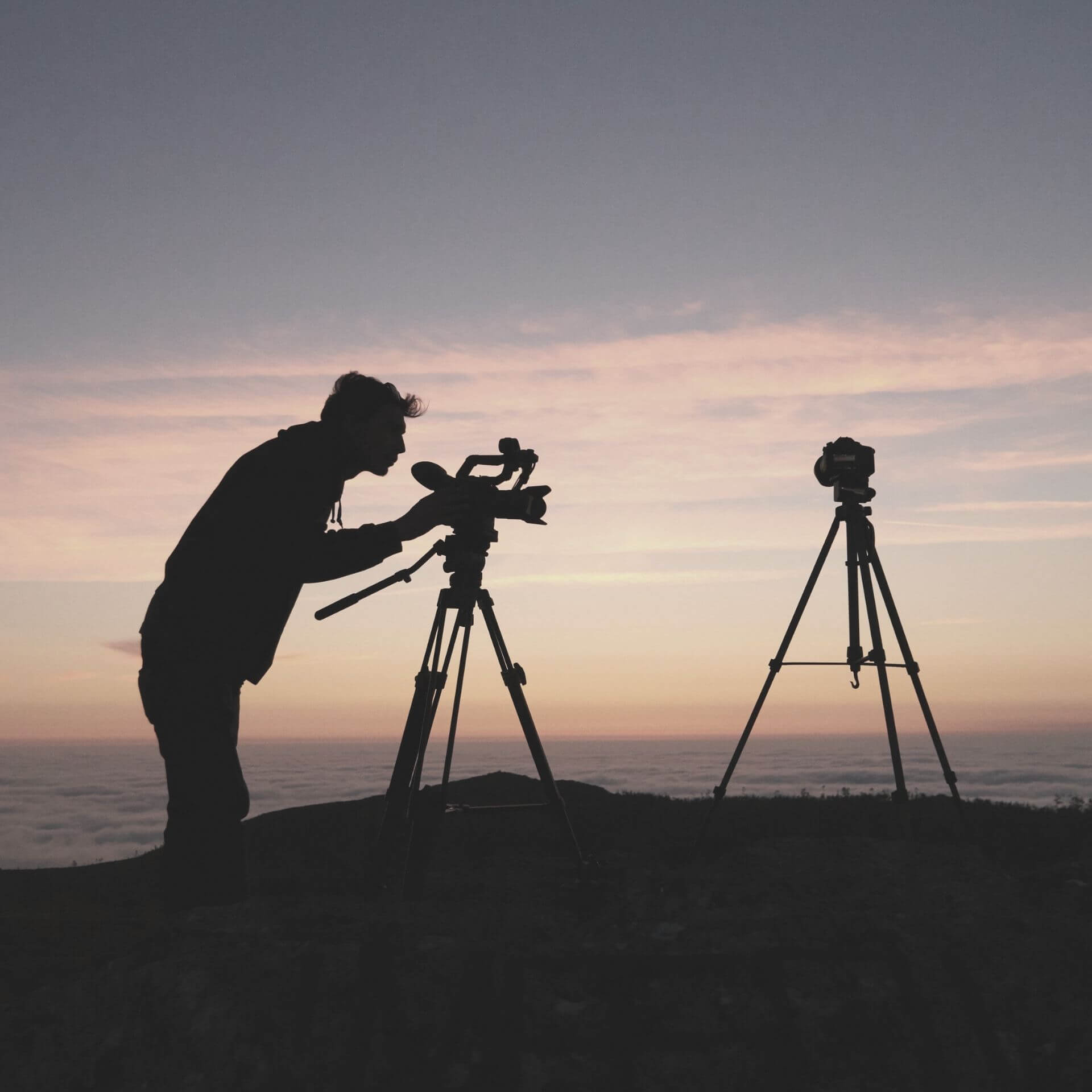 Video Marketing Man with video camera at dusk