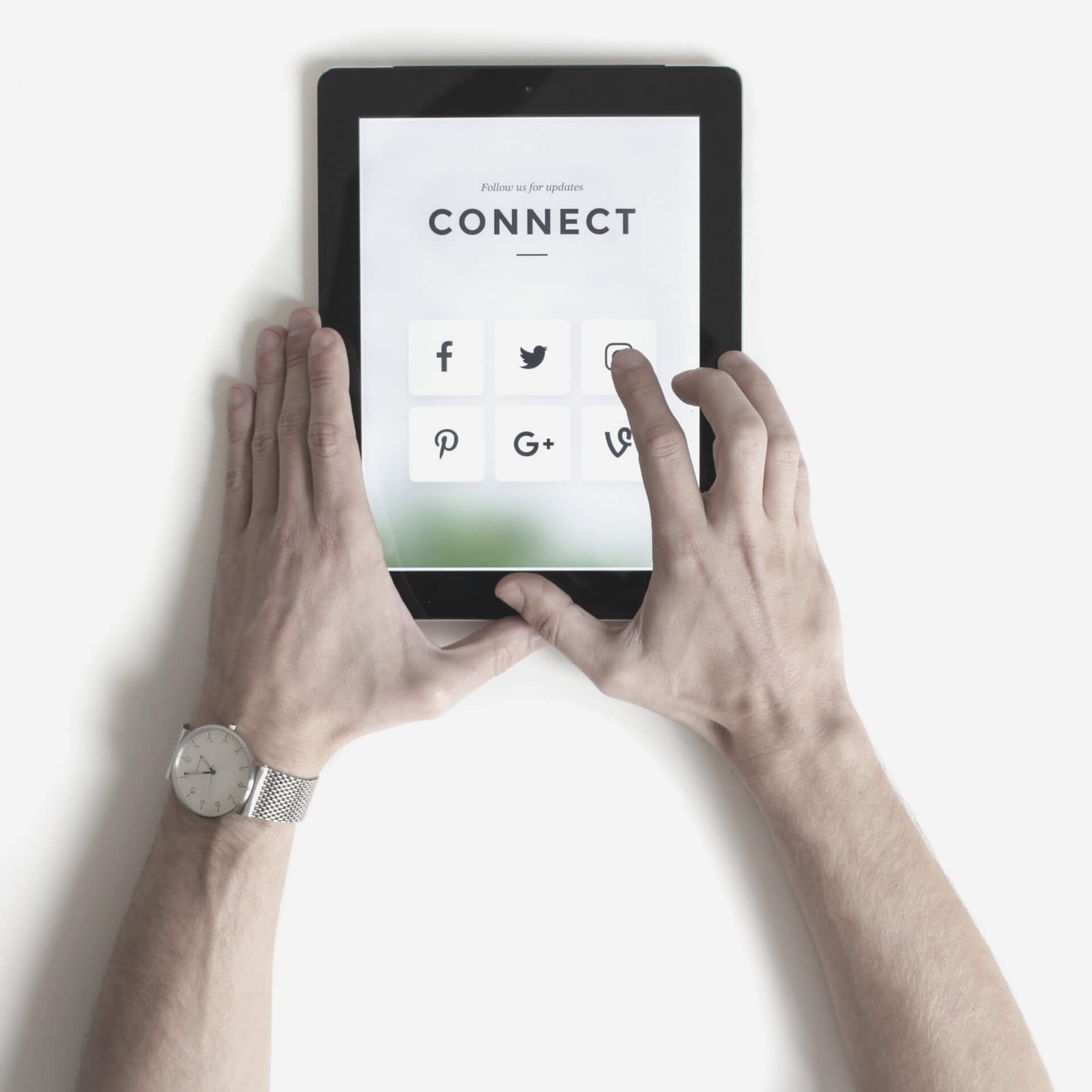 "social media marketing packages: hands holding a tablet with the word ""Connect"" above social media icons."