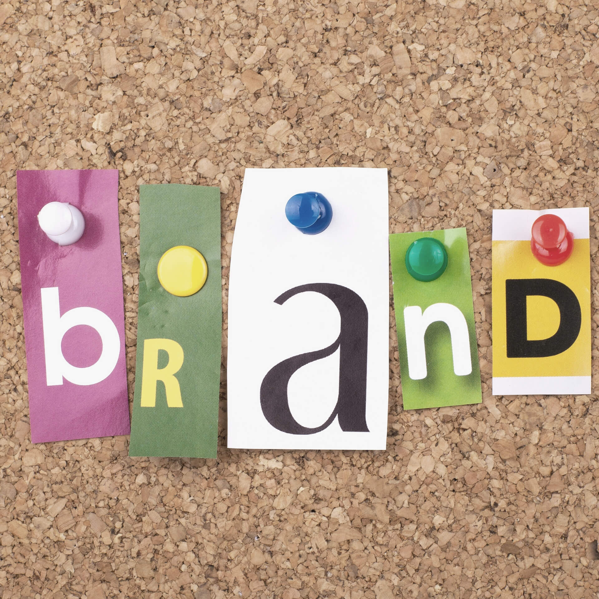 "brand style guide: cut-out letters on a cork board that spell ""brand"""