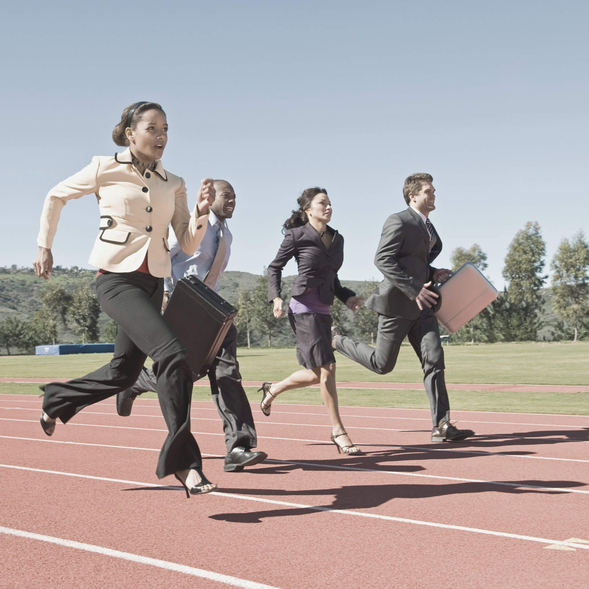 keep up with competitor content strategies: people in business attire running on a race track