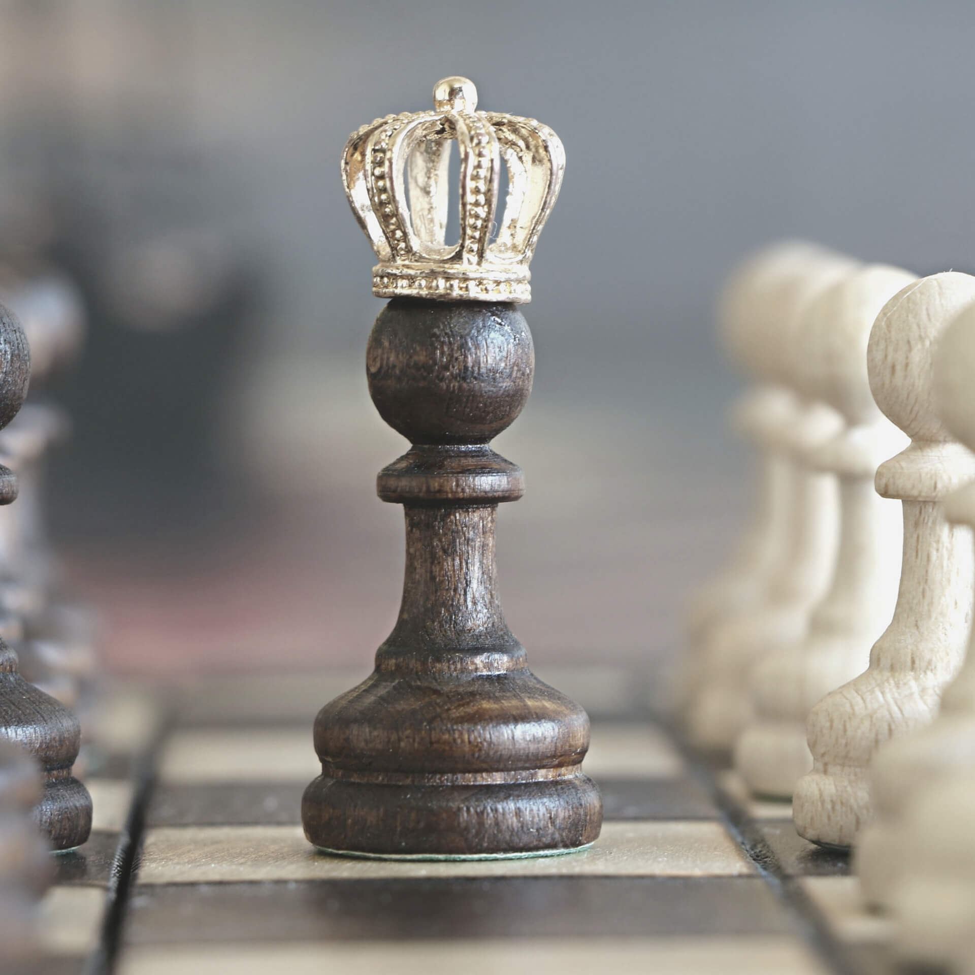 content strategist: chess pawn with a crown on it's head