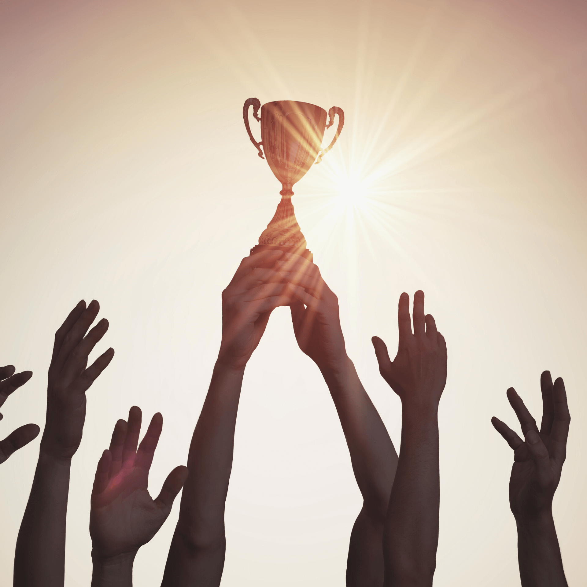 Customer Personalization wins every time. Hands holding up a trophy back lit by the sun.