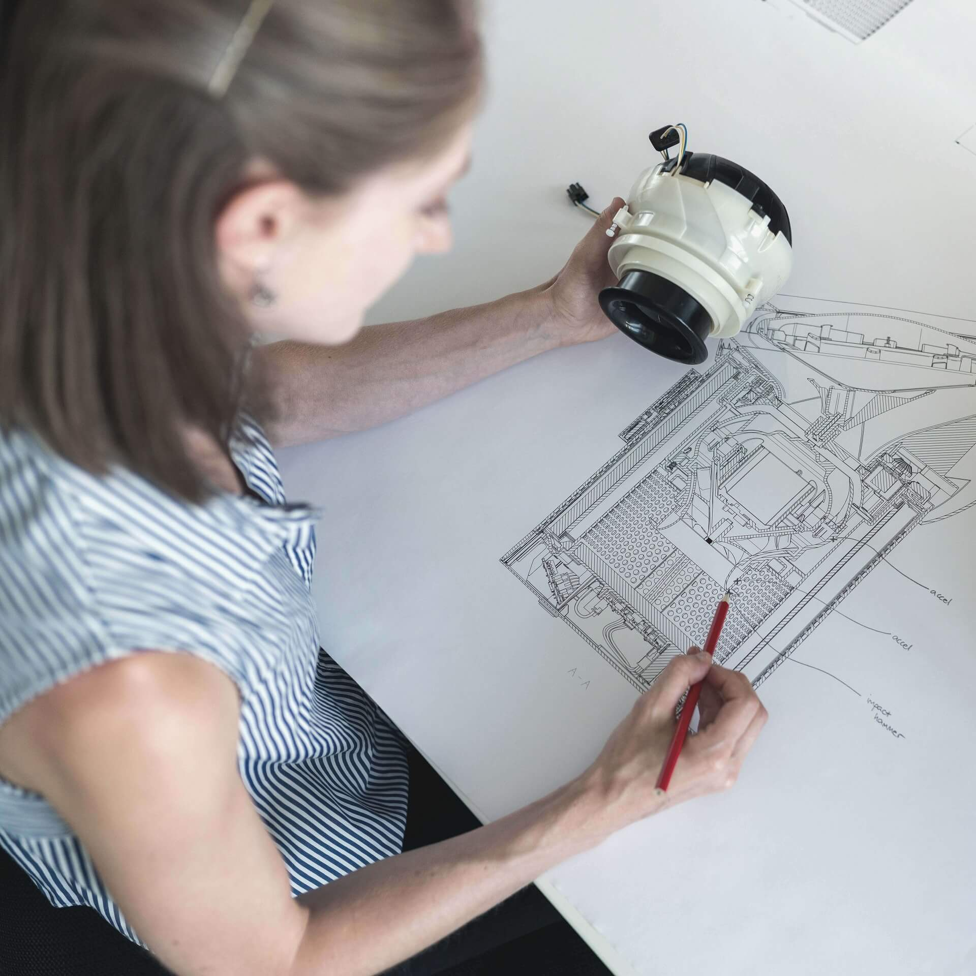 Brand Building: Business woman looking over blueprints