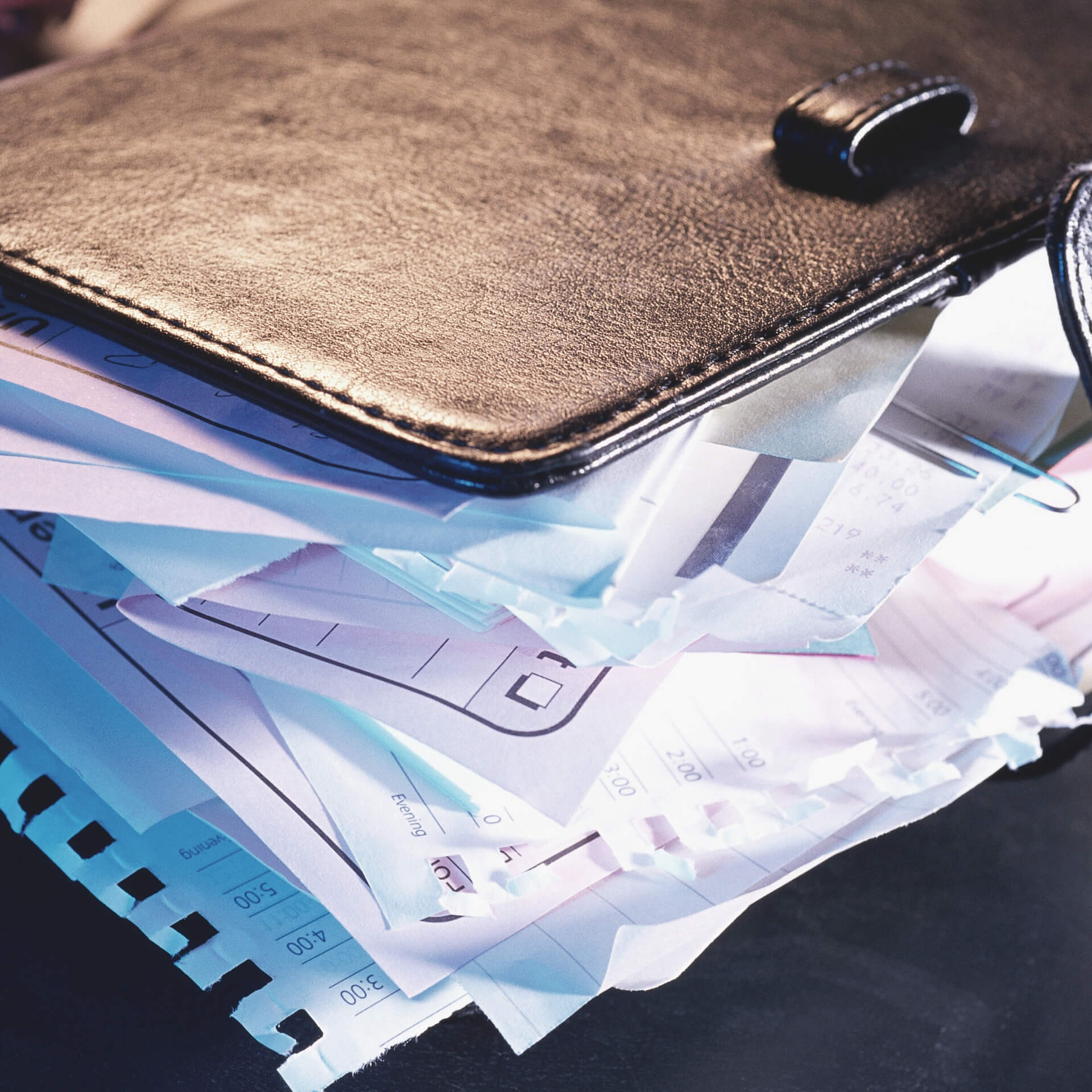 Organize Your Blog: A planner full of unorganized loos paper.