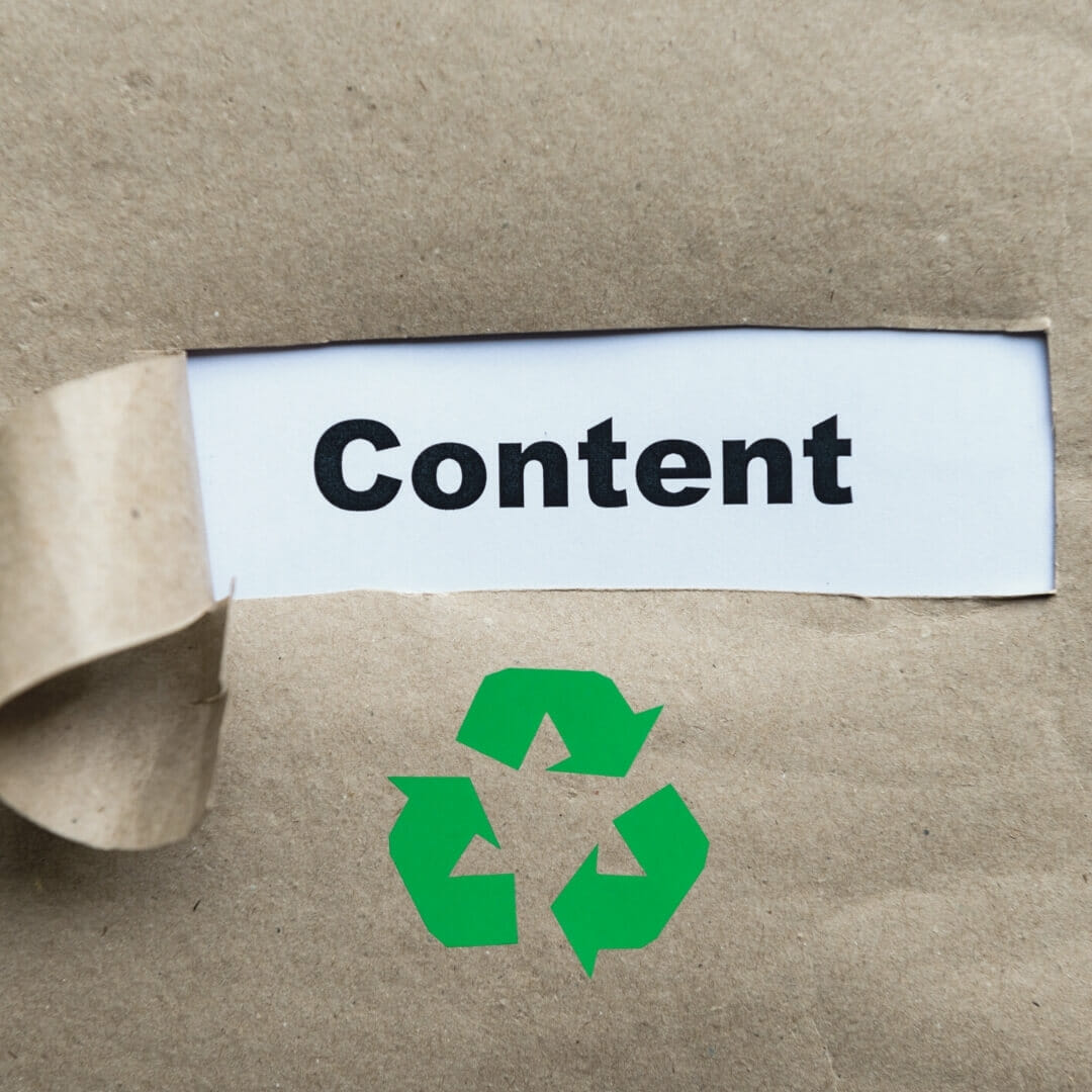 """Repurpose Blog Content: Paper bag labeled """"content"""" with a recycle symbol below it."""