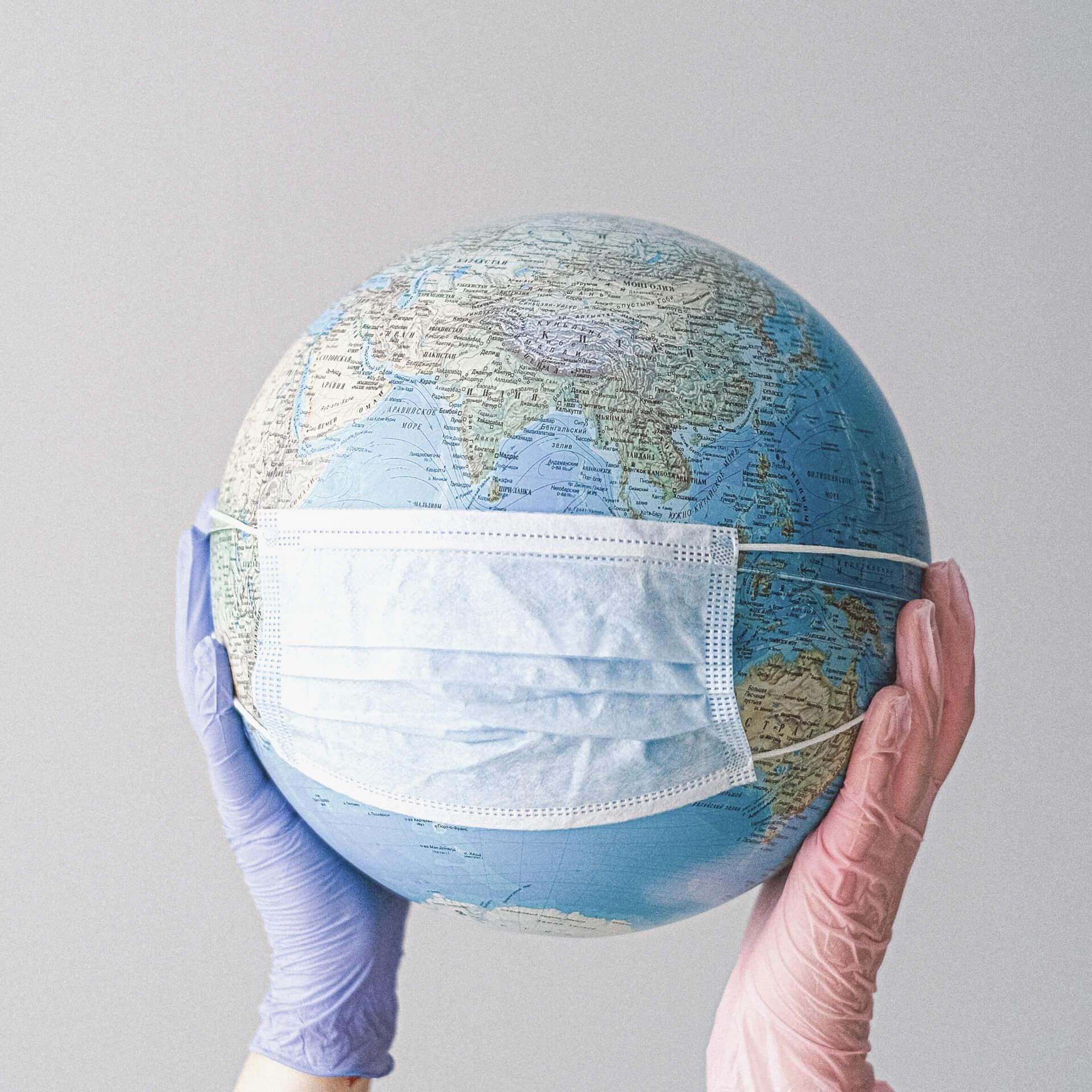 Virtual Nonprofit: Globe wearing a facemask.