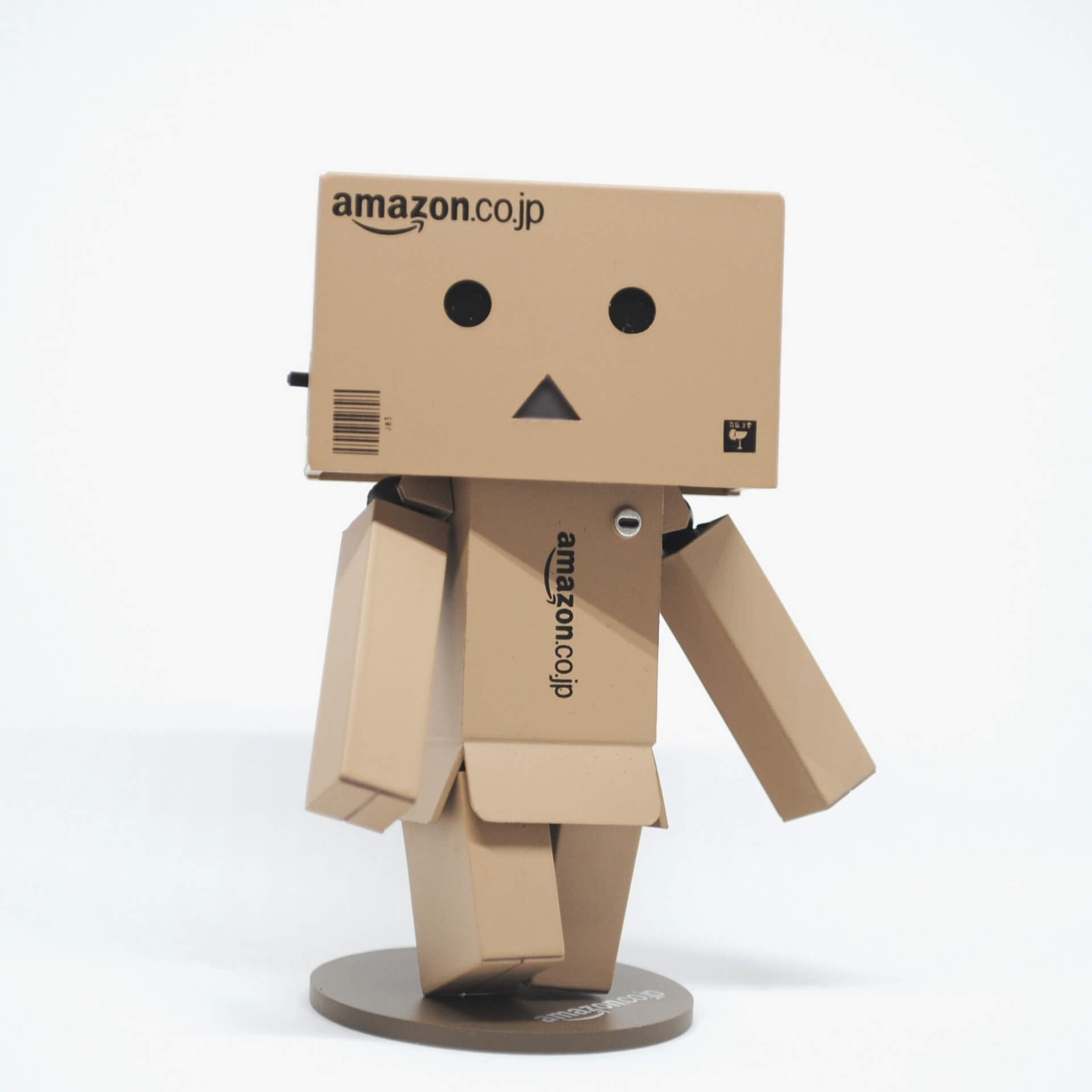 Amazon Smile: Confused robot made out of Amazon shipping boxes.
