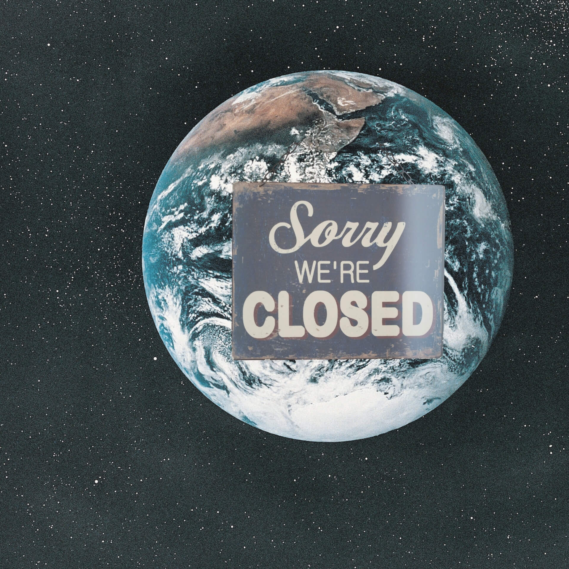 "pandemic business marketing: The earth with a sorry we're closed"" sign hanging on it."